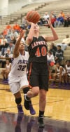 LaPorte's Kelsey Gushrowski drives to the basket while Merrillville's Erika McClinton tries to defend Friday.