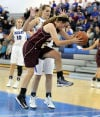 Chesterton's Jordan Wadding tries to stop the ball from bouncing out of bounds while Lake Central's Emily Miklusak defends