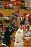Hammond's Michael Kirkendall and Munster's Craig Dedelow vie for a rebound