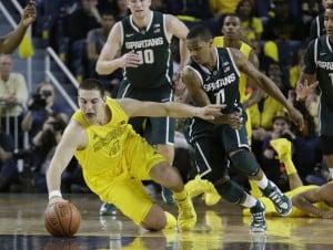 Burke's defensive plays help Michigan beat MSU