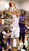 Valparaiso's John Mosser shoots against Merrillville's Zoran Talley on Friday.