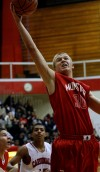 Munster's Nate Babash steals a rebound from E.C. Central on Saturday.