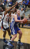 West Side's Tyeisha Hunter tries to stop a shot by Lake Central's Lindsay Kusbel during Friday night's semfinals of the Class 4A Lowell Sectional.