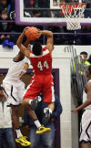 Homewood-Flossmoor's Grady Malcolm shoots against Marian Catholic's Ezra Pointer-Jones in Marian's win in the Class 4A Thornton Sectional final Friday.