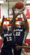 Bishop Noll's Marquis Tarver and Tyreon Gates both go for a rebound during Friday night's game at Andrean.