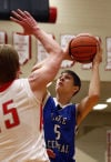 Lake Central's Ian Martin shoots over Crown Point's Sasha Stefanovic on Friday night.