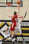 Portage's David Clegg shoots over Griffith's Chad Noldin on Friday night.