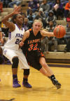 LaPorte's Taylor Thompson drives around Merrillville's Jaz Talley Friday.