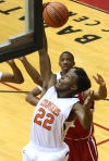 West Side's Marlon Northern grabs a rebound Wednesday against host E.C. Central in Class 4A sectional play.