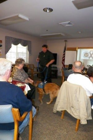 Barnabus the Comfort Dog attends Portage Exchange Club meeting
