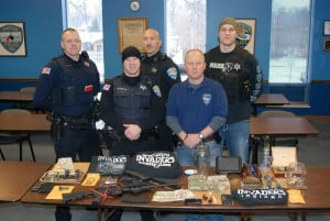 Portage police arrest four during drug raid