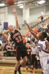 LaPorte's Taylor Thompson shoots over Merrillville's Victoria Gaines on Friday night.