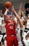 Munster's Pat McCarthy shoots against Lowell's William Barker on Friday night.