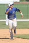 Lake Central's Alex Olund heads to third base