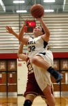 Bishop Noll's Tori Keilman drives against River Forest in the GSSC tourney championship.