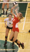 Crown Point's Alyssa Kvarta sets against Valparaiso on Tuesday night.