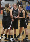 Lowell's Joselyn Bobos is congratulated by her teammates after making the game-winning shot at the free-throw line during Friday night's Class 4A Lowell Sectional semifinals against Morton.