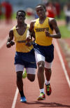 Mubarick Olaoye, left, and Steve Fleshman of Thornwood compete in the 3,200-meter relay during the Thornton Classic on Saturday.