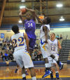 Merrillville's Jarius Stevens slices through a host of Highland defenders during a layup Friday night.