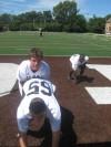 Mt. Carmel center John Mucha snaps to quarterback Chris Sujka in August.