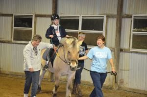 Horses provide therapy for special needs riders