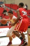 Crown Point's Alex Nickla drives against Morton's Travon Atkins