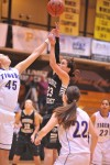 Purdue Calumet's Amanda Gaskin shoots over Olivet Nazarene's Sandy Cabadas on Wednesday night.