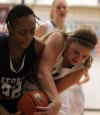 Washington's Victoria Bradley and Illiana Christian's Megan Knapper fight for the ball