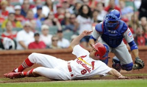 Rizzo homers in Cubs' 6-4 loss to Cardinals