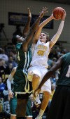 Valparaiso University's Ryan Broekhoff shoots over Chicago State's Nate Henry