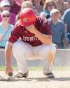 Munster's John Pitsas reacts after striking out in the bottom of the sixth