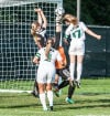 LaPorte keeper Madison Barber deflects a header by Valparaiso's Grace Withrow