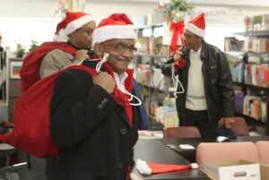 Santa volunteers distribute books