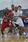 Lake Central junior Glenn Robinson III drives down court