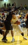 Purdue Calumet's Roddy Richardson tries to stop a shot attempt by Valparaiso University's Bobby Capobianco