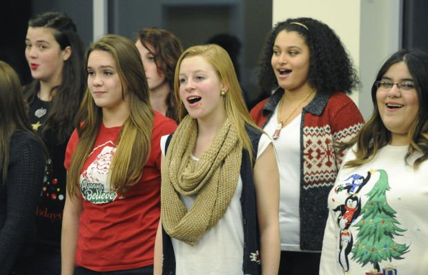 Crown Point student groups perform holiday music at library