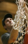 Kevin Van Vijk cuts down the net after Valparaiso defeated Wright State in the Horizon League men's basketball tournament championship.
