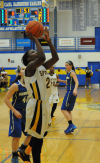 Marian Catholic's Ashton Millender shoots during Thursday's Class 4A Sandburg Regional championship.