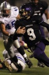 Merrillville quarterback Jake Raspopovich runs for a touchdown