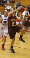 Chesterton's Jordan Wadding drives for a layup against E.C. Central on Tuesday.