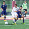 Chesterton's Gabe Mihut, left, battles with Merrillville's Juan Padilla