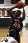 West Side's Lonnie Johnson shoots over Lowell's Aaron Hamm on Saturday.
