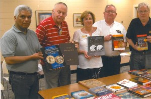Oldest coin club in Indiana donates books to library