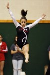 Portage's Danielle Solis performs on the balance beam Friday