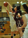 Purdue Calument's Kami Graber has her shot blocked by Robert Morris' Yolanda De La Tore on Wednesday night.