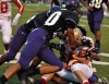 Andrean's Owen Satoski is gang tackled by Merrillville defenders Saturday.