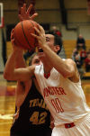 Munster's Adam Ostoich drives under Chesterton's Jacob Wasielewski during Tuesday's game.