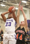 Merrillville's Riana Todd goes up for a shot against LaPorte's Kate Ulmer on Friday.
