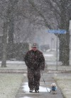 Snow begins falling on region; flights canceled