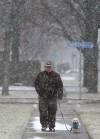Snow begins falling on region; flights canceled